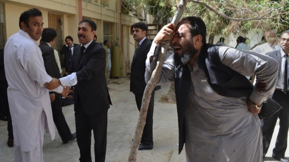 Pakistani lawyers mourn the deaths of their colleagues following a bomb blast in QuettA.