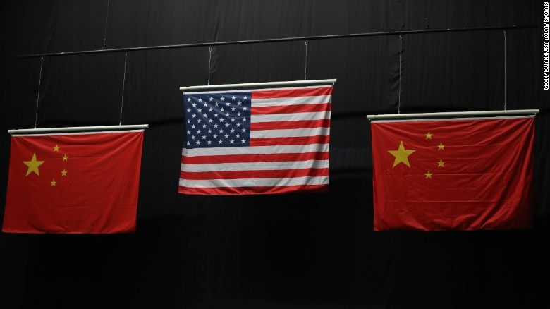 The American flag flies above the Chinese flags after Virginia Thrasher took the gold medal in the 10m air rifle competition.