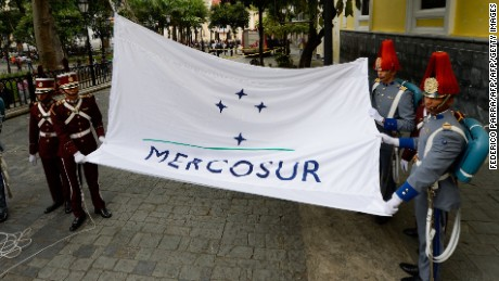 The Mercosur flag is raised in front of the Venezuelan Foreign Office building, in Caracas on August 5, 2016. The act ocurred after a meeting in Montevideo in which the founder members couldn't agree on the leadership transfer. Argentina, Brasil and Paraguay are against Venezuela's leadership of the economic block.  / AFP / FEDERICO PARRA        (Photo credit should read FEDERICO PARRA/AFP/Getty Images)