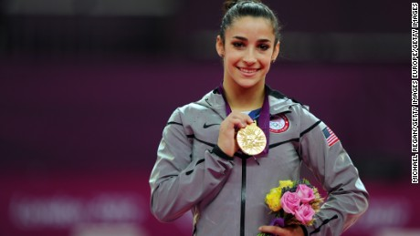 Aly Raisman displays her gold medal for the women's floor exercise during the London 2012 Olympics.