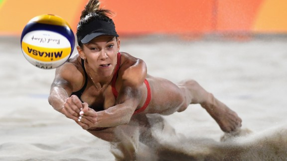 Canada's Jamie Lynn Broder dives for the ball during a beach volleyball match on Sunday, August 7.