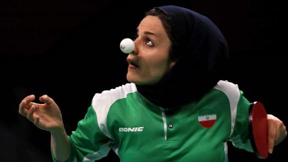 Iran's Neda Shahsavari plays a first-round table tennis match on Saturday, August 6.