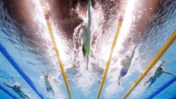 Russia's Aleksandr Krasnykh leads a group of swimmers during a 400-meter freestyle race on Saturday, August 6.