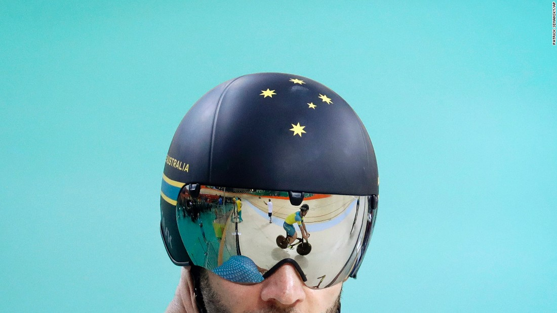 An Australian cyclist is reflected on a teammate's visor during a training session on Thursday, August 4.