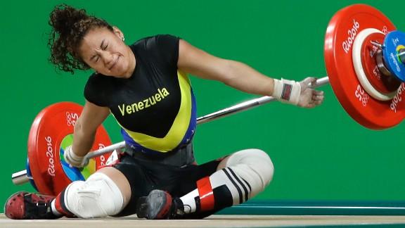 Venezuelan weightlifter Yusleidy Figueroa falls as she competes in the 58-kilogram weight class.