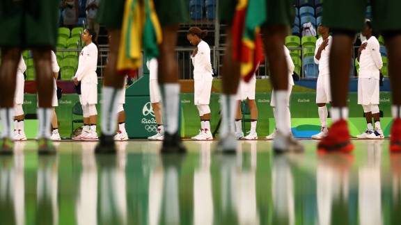 The women's basketball teams from Senegal and the United States line up before their preliminary round game on Sunday, August 7. The United States won 121-56, breaking their record for most points scored in the Olympics.