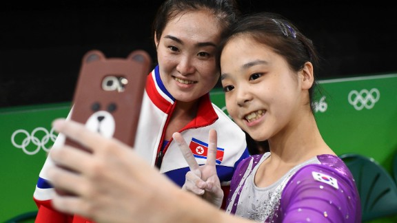 South Korean gymnast Lee Eun-ju takes a selfie with North Korean gymnast Hong Un-jong during training. Relations have been frosty between the North and South since its division following the end of World War II, but geopolitics were put to the side as the two Olympians came together.