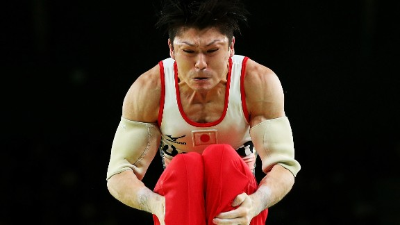 Japanese gymnast Kohei Uchimura -- the reigning Olympic champion -- competes on the parallel bars during the team all-around event. Japan won the gold.