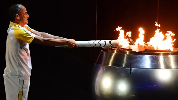 Vanderlei Cordeiro de Lima, a former Brazilian long-distance runner, lights the Olympic cauldron during the opening ceremony in Rio de Janeiro on Friday, August 5. De Lima was leading the Olympic marathon in 2004 when he was attacked by a protester near the end of the race. He ended up finishing third, but the graceful way he handled the disappointment won him plaudits around the world for his sportsmanship.
