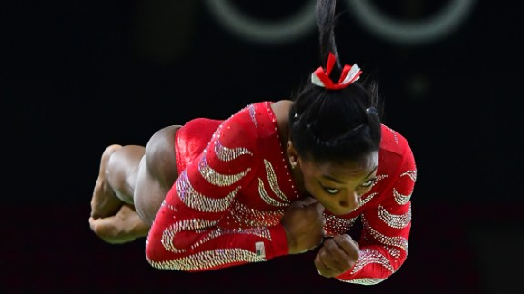U.S. gymnast Simone Biles -- the reigning world champion in the all-around -- trains on the vault on Thursday, August 4.