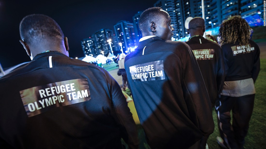 "Athletes with the Refugee Olympic Team attend a welcoming ceremony on Wednesday, August 3. Half of the 10-member team is from South Sudan. Two members fled Syria, two left the Democratic Republic of the Congo, and one is originally from Ethiopia. <a href=""http://www.cnn.com/2016/08/06/sport/rio-2016-refugee-team-olympics-syria/"" target=""_blank"">Meet the team</a>"