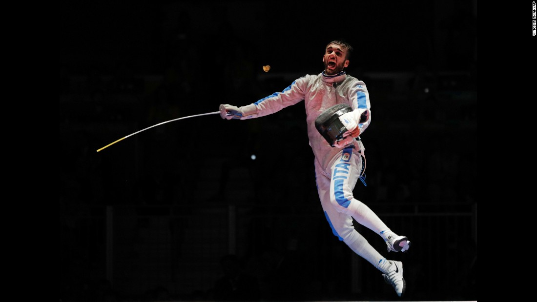Italian fencer Daniele Garozzo leaps into the air after winning gold in the individual foil event on Sunday, August 7.