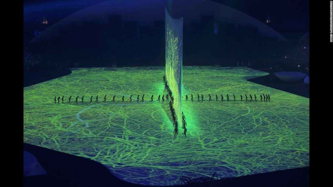 The opening ceremony included lasers, 3-D projections and a cascade of water enveloping the stage on Friday, August 5.