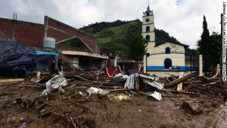 View of damage caused by a landslide ensuing the passage of Tropical Storm Earl in the community of Xaltepec, Puebla state, eastern Mexico on August 8, 2016.  A total of 29 people died in the communities of Xaltepec, Tlaola and Huauchinango in the Mexican state of Puebla after their homes were buried by landslides following heavy rains from Earl, which reached Mexican territory on Thursday as a tropical storm and Saturday was only a remnant low pressure. / AFP / AE / ALFREDO ESTRELLA        (Photo credit should read ALFREDO ESTRELLA/AFP/Getty Images)