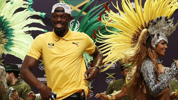 Sprinter Usain Bolt, center, dances the samba during a news conference for Puma and the Jamaican Olympic Association. The world's fastest man will be defending his 100-meter title later in the Games.