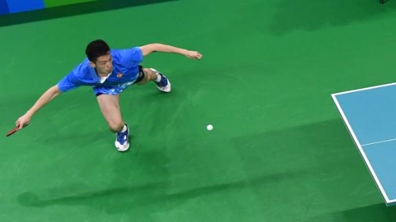 Hong Kong's Wong Chun Ting, left, plays Japan's Koki Niwa in table tennis. Niwa won to clinch a spot in the quarterfinals.