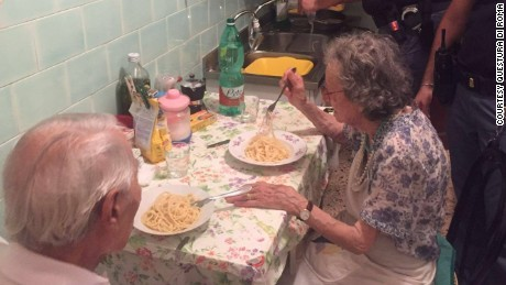 Roman police officers cook an elderly Italian couple pasta, after being called to the scene where crying was heard.