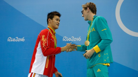 "Silver medalist Yang Sun of China and gold medalist Mack Horton of Australia shake hands after the 400-meter swimming freestyle on Saturday, August 6. The Australian had opened up a war of words against his Chinese opponent in the buildup to the final, saying: ""I don't have time or respect for drug cheats."""