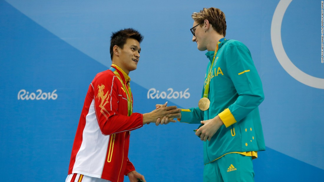 "Silver medalist Yang Sun of China and gold medalist Mack Horton of Australia shake hands after the 400-meter swimming freestyle on Saturday, August 6. The Australian had <a href=""http://edition.cnn.com/2016/08/06/sport/horton-yang-swimming-rio-olympics-day-one/"" target=""_blank"">opened up a war of words</a> against his Chinese opponent in the buildup to the final, saying: ""I don't have time or respect for drug cheats."""