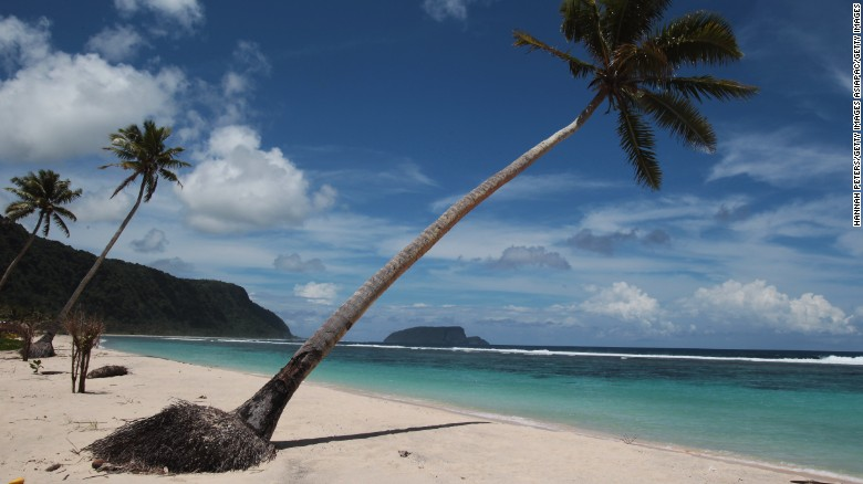 APIA, SAMOA - SEPTEMBER 30:  Palm trees line a clean beach on September 30, 2010 in Saleapaga, Samoa. 189 people were killed and hundreds more injured in Samoa, American Samoa, and Tonga in 2009.  (Photo by Hannah Peters/Getty Images)