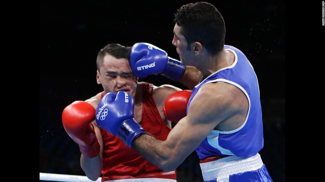 Mexico's Misael Uziel Rodriguez, left, takes a battering from Iraq's Waheed Abdulridha Waheed Karaawi during a middleweight boxing match. Rodriguez won the match, however, and advanced.