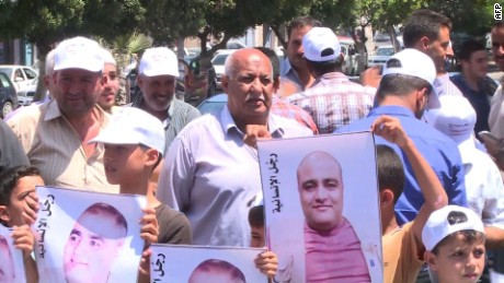 Gaza residents protest the arrest of Mohammad El-Halabi, the Gaza director of World Vision.