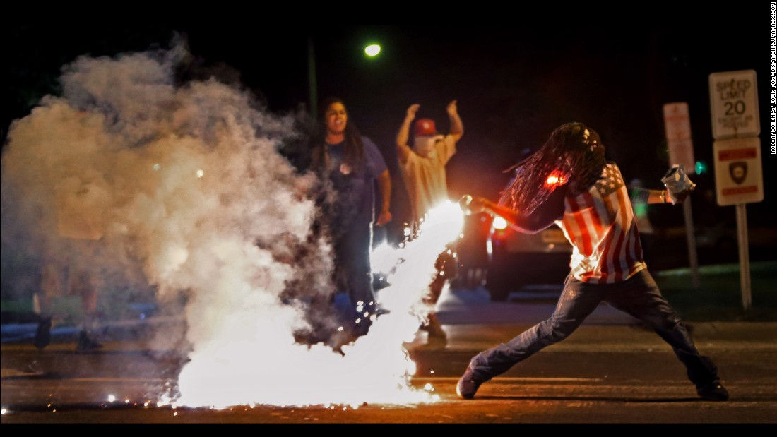 This is one of the most famous images from Ferguson, taken just four days after Brown's death. It captured a protester returning a tear gas canister fired by police who were trying to disperse the crowds.