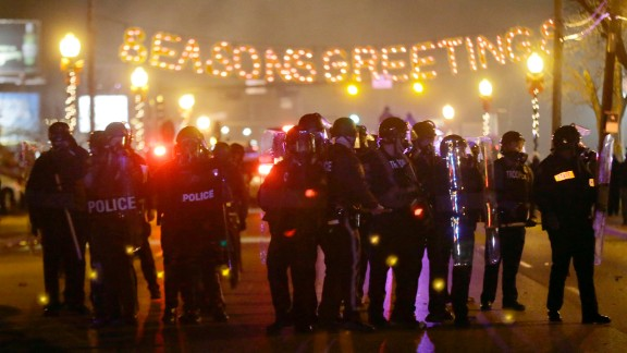 After a grand jury decided in November 2014 not to indict Wilson in Brown's death, Ferguson erupted in protests. Some were peaceful, but other demonstrators threw rocks and bottles at police who responded with tear gas.