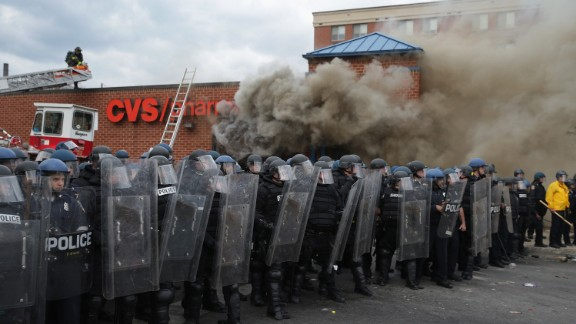Baltimore Police form parimeter around a CVS pharmacy that was looted and burned after 2015 funeral of Freddie Gray.