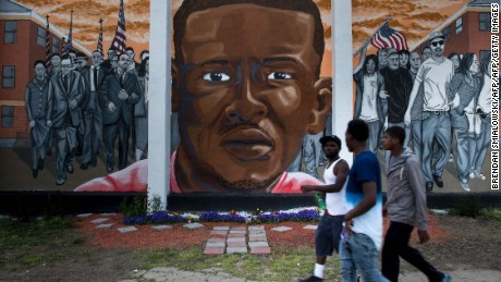 The DOJ began investigating Baltimore police after the death of Freddie Gray, seen on a mural here.