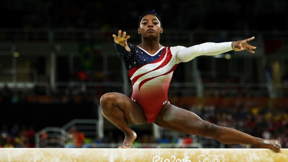 Remember that the balance beam in gymnastics is only 4 inches wide. Near the start of Biles' balance beam performance she does an extremely difficult element called the Wolf Turn. Squatting on her right foot, with her arms and left leg outstretched -- she spins two-and-a-half times around. Then, without falling, Biles stands upright to continue her routine.