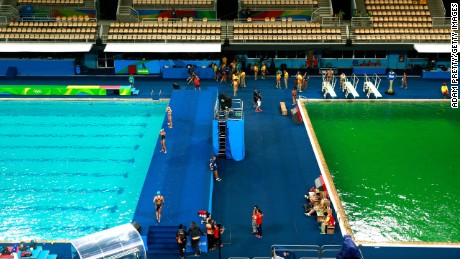 Divers canceled practice sessions after the pool turned green.