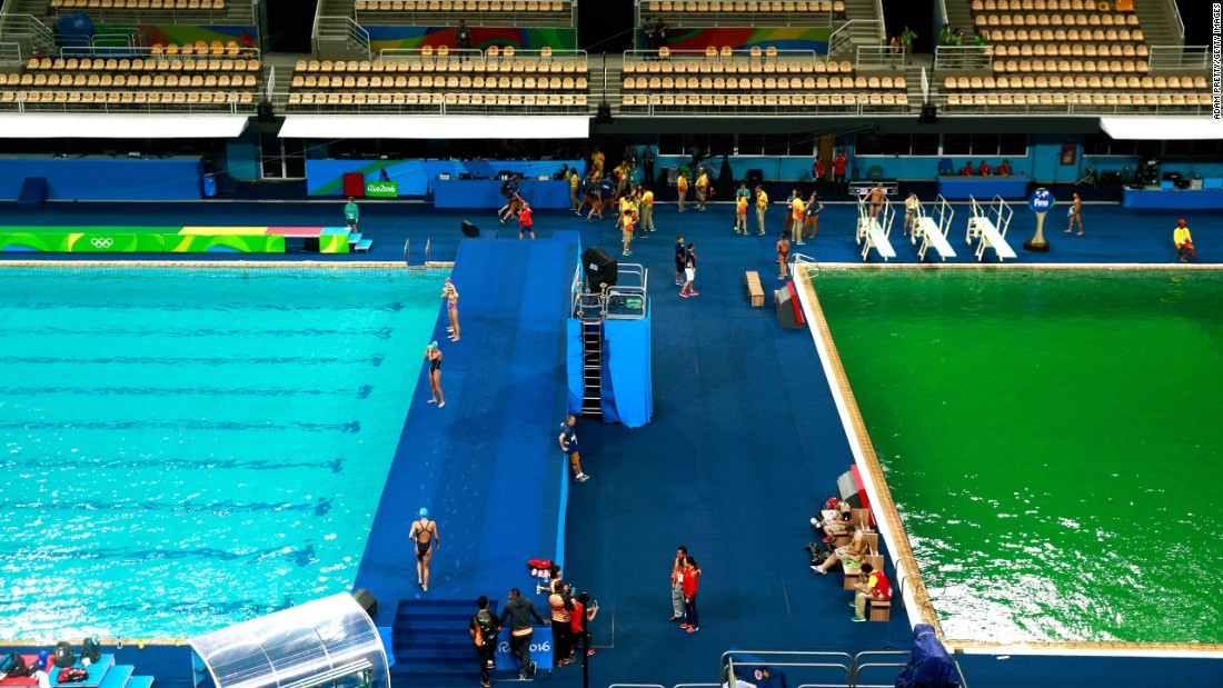 "The diving pool, right, is seen on Tuesday, August 9. The pool had turned from <a href=""http://www.cnn.com/2016/08/09/sport/rio-olympics-green-pool/"" target=""_blank"">blue to green</a> since Monday.<br />"