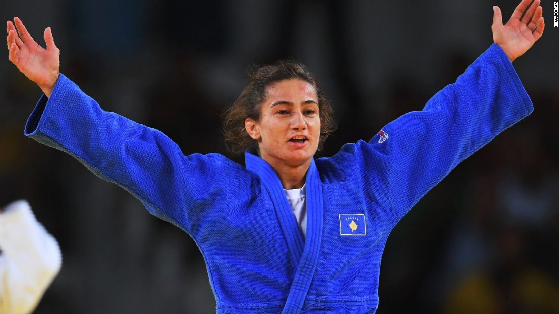 "When Kelmendi fights, an entire nation stands still. The 26-year-old is more than just a talented judoka -- she's Kosovo's biggest sporting icon. Her face adorns billboards all over her home city of Peja, where locals speak in hushed tones about their country's first ever Olympic champion. Her legacy is equally unmistakable, with a new generation of Kosovar stars emerging in her wake. ""Through judo I became somebody,"" <a href=""https://edition.cnn.com/2018/03/08/sport/legends-of-judo-majlinda-kelmendi-kosovo-spt/index.html"">Kelmendi</a> told CNN ahead of Rio 2016. ""I don't do it because of money, I don't do it because I wanted to get famous. I do judo because I feel it, I love it -- it makes me feel good, makes me feel special."""