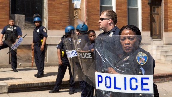 File Photo: Police form a line to block North Ave., near the site of recent riots and several blocks away from where Freddie Gray was arrested last month, May 4, 2015 in Baltimore, Maryland.  Initial reports that a man had been shot by police sparked anger in the crowd.  Officials later reported that no one had been injured and the gun, carried by a man seen  on a security camera, had discharged accidentally.
