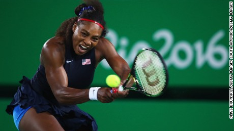 RIO DE JANEIRO, BRAZIL - AUGUST 08:  Serena Williams of the United States plays a backhand during the Women's Singles second round match against Alize Cornet of France on Day 3 of the Rio 2016 Olympic Games at the Olympic Tennis Centre on August 8, 2016 in Rio de Janeiro, Brazil.  (Photo by Clive Brunskill/Getty Images)