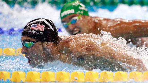 South Africa's Chad Le Clos, right, looks over at U.S. swimmer Michael Phelps during the 200-meter butterfly final on Tuesday, August 9. Ahead of their semifinal, the two were seen on camera as Le Clos shadowboxed while Phelps just watched.