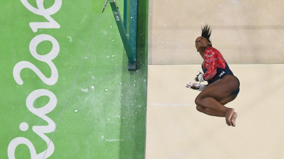 """You may already know that U.S. Olympic gold medal gymnast Simone Biles has a signature move named after her called """"The Biles."""" In fact Biles has an entire catalog of specialized maneuvers at her command when she performs a floor exercise, or on the balance beam, the uneven bars or the vault. Click through the gallery to see some of Biles' most breathtaking tumbles, dismounts and other moves that have wowed the world during her time at the 2016 Olympics in Rio de Janeiro."""