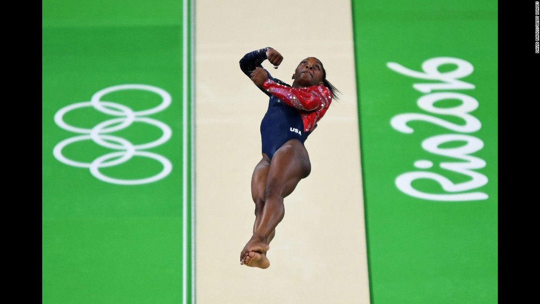 "The Amanar vault has been called ""one of the hardest vaults performed by women."" Biles has been praised for her consistency and height when performing this move. Here's how it works: As the gymnast runs up to the horse, she hits the mat with her hands into a round-off, then hits her feet onto the spring board to do a back handspring onto the horse. Finally, she flips off the horse into a twisting layout back flip, landing facing the horse."