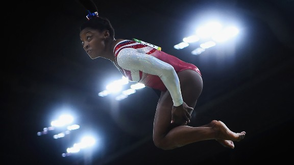 """Her ability to jump high and maintain momentum in midair comes from a combination of her short stature and great strength. That's one reason why you'll see Biles perform so many """"double-doubles."""" A double-double is a challenging double-twisting, double-back somersault tumbling move. You need to jump very high to have time to do all that twisting and flipping. Biles packs a lot of power into her 4 feet, 8 inches."""