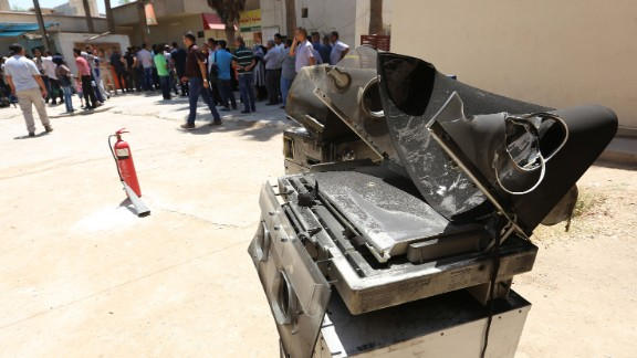 Burned incubators stand outside Baghdad's Yarmouk hospital Wednesday after a deadly fire.