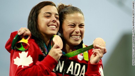 RIO DE JANEIRO, BRAZIL - AUGUST 09:  (L-R) Bronze medalists Meaghan Benfeito and Roseline Filion of Canada celebrate during the medal ceremony for the Women's Diving Synchronised 10m Platform Final on Day 4 of the Rio 2016 Olympic Games at Maria Lenk Aquatics Centre on August 9, 2016 in Rio de Janeiro, Brazil.  (Photo by Adam Pretty/Getty Images)