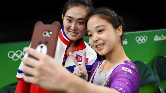 South Korean gymnast Lee Eun-ju takes a selfie with North Korean gymnast Hong Un-jong during training on Thursday, August 4. Relations have been frosty between the North and South since its division following the end of World War II, but geopolitics were put to the side as the two Olympians came together.