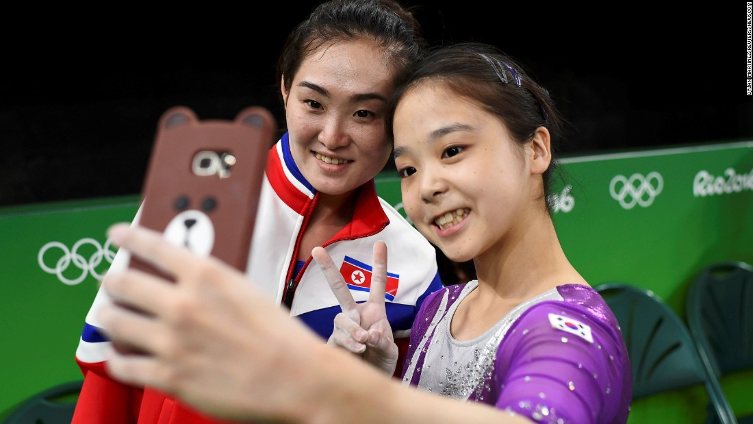 "South Korean gymnast Lee Eun-ju <a href=""http://www.cnn.com/2016/08/08/sport/korea-gymnast-selfie/index.html"" target=""_blank"">takes a selfie</a> with North Korean gymnast Hong Un-jong during training on Thursday, August 4. Relations have been frosty between the North and South since its division following the end of World War II, but geopolitics were put to the side as the two Olympians came together."