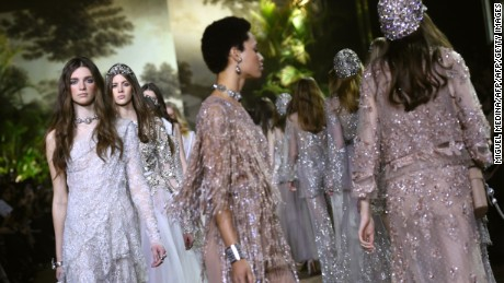 Models present creations by Elie Saab during the 2016 spring/summer Haute Couture collection on January 27, 2016 in Paris.   AFP PHOTO / MIGUEL MEDINA / AFP / MIGUEL MEDINA        (Photo credit should read MIGUEL MEDINA/AFP/Getty Images)