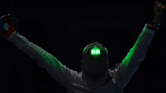 South Korean fencer Kim Jung-hwan celebrates after beating Georgia's Sandro Bazadze in the men's individual sabre competition. Kim finished with the bronze medal.