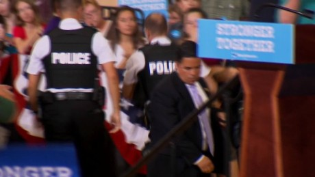 Protester tries to storm the stage as Clinton speaks in Iowa_00002529