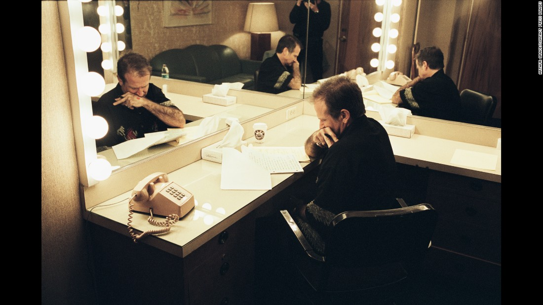 Williams goes over notes in his dressing room before a 2002 show at Harrah's Lake Tahoe in Nevada. About 150 of the book's 190 photos have never been published, Grace said.