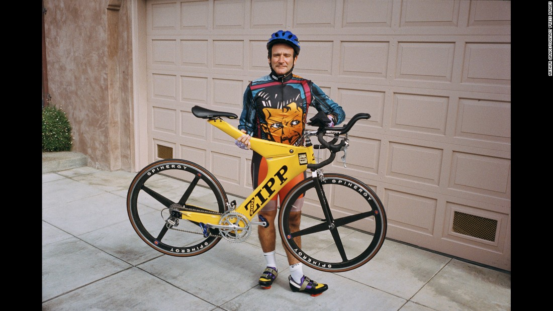 Williams in 1995 holds one of his lightweight bicycles outside his San Francisco garage, which held 20 more. When the entertainer had a film coming out, Grace would go to Williams' home and take pictures of routine activities like bike riding. He'd then distribute them through a photo agency for distribution to magazines in conjunction with the movie's release.