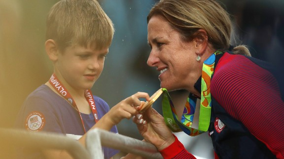 Kristin Amrstrong celebrates with her five-year-old son Lucas after winning gold.